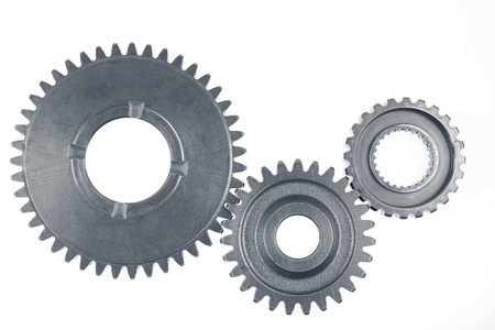 Metal gears on plain background photo