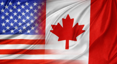 united states of america: American and Canadian flags together