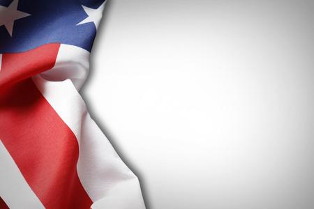Closeup of American flag on plain background photo