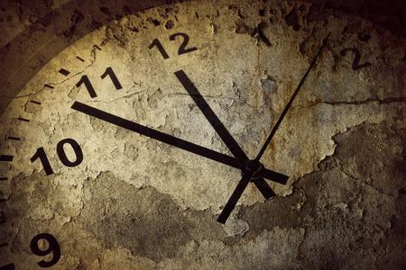 Closeup of hands on grunge clock face Archivio Fotografico