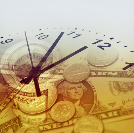 Clock and American currency. Time is money concept photo