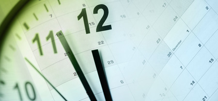time of the year: Clock face and calendar composite Stock Photo