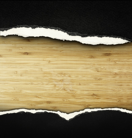 Ripped paper on wood, space for copy photo