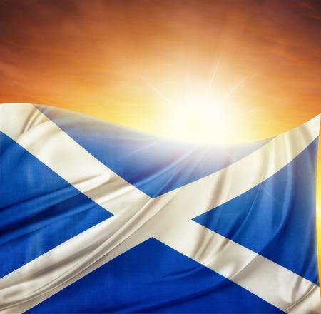 scottish flag: Scottish flag in front of bright sky Stock Photo