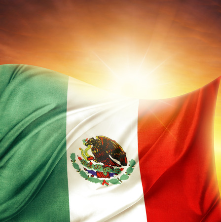 Mexican flag in front of bright sky