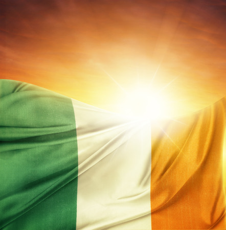 Irish flag in front of bright sky photo