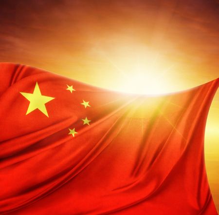 in chinese: Chinese flag in front of bright sky Stock Photo
