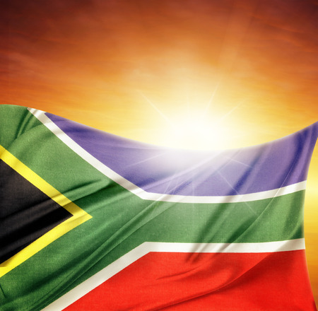 South African flag in front of bright sky Stock Photo