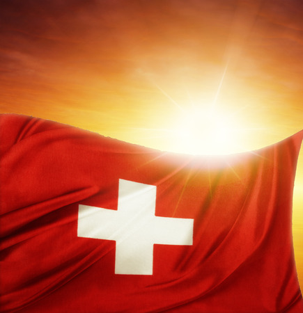 swiss insignia: Swiss flag in front of bright sky