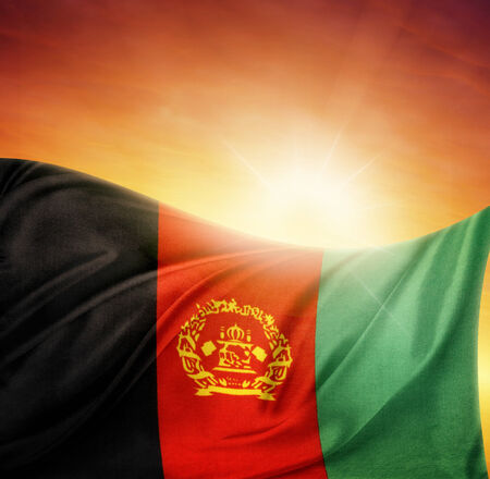 afghan flag: Afghanistan flag in front of bright sky Stock Photo
