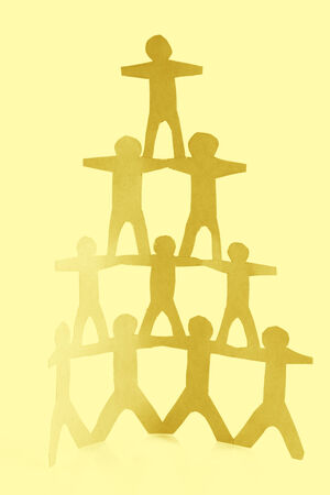 Human team pyramid holding hands photo
