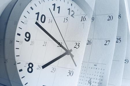 Clock face and calendar pages Foto de archivo