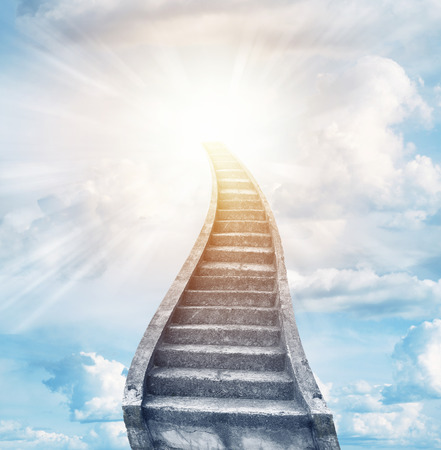Stairway leading up to bright light Stock Photo