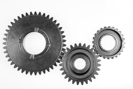 Metal gears on plain background
