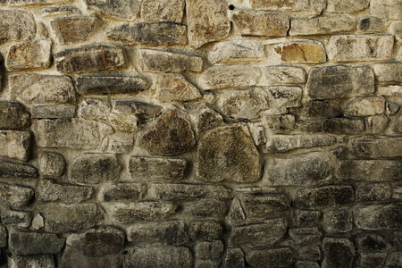 Closeup of brown rock wall photo