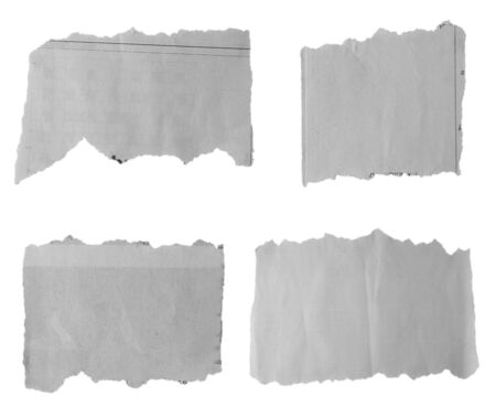fray: Four pieces of torn paper on plain background