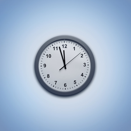 Clock on blue background photo