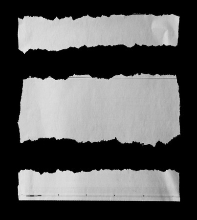 torn paper background: Three pieces of torn paper on black. Copy space Stock Photo