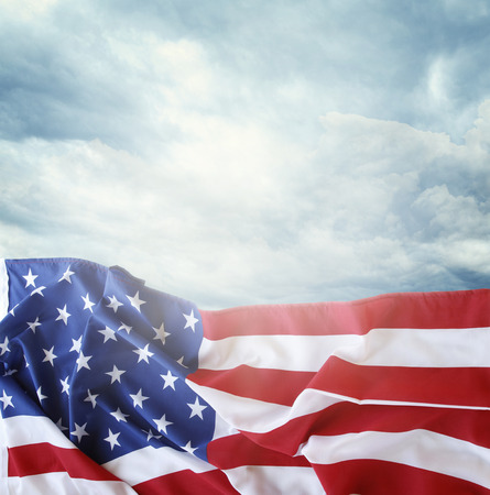 the united states flag: American flag in front of sky