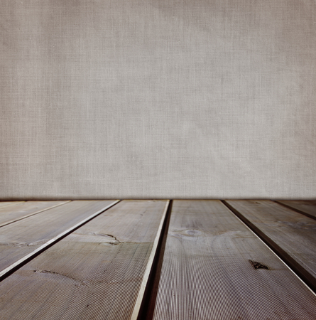 floorboards: Wooden floorboards and blank wall
