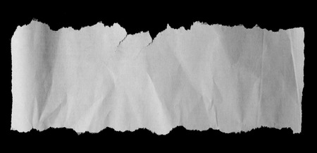 Piece of torn paper on black. Copy space