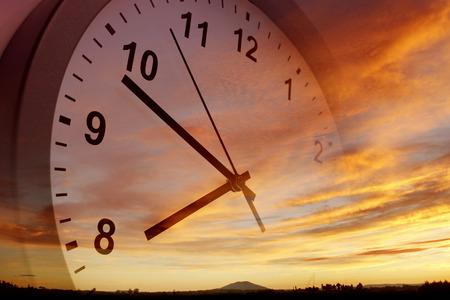 Clock face in bright sky Archivio Fotografico