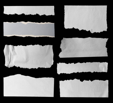 newspaper blank: Eight pieces of torn paper on black. Copy space Stock Photo