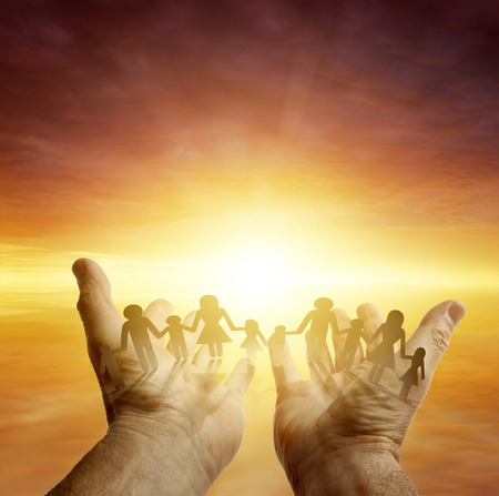 Family in hands. Bright sky photo