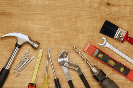 Assorted work tools on wood photo