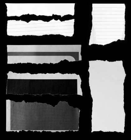 torn paper edge: Pieces of torn paper on black. Copy space