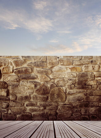 Wooden floorboards and rock wall photo
