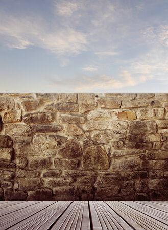 floorboards: Wooden floorboards and rock wall Stock Photo