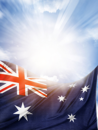 Australian flag in front of bright sky