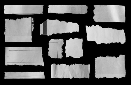 Pieces of torn paper on black photo