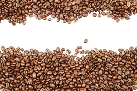 Closeup of coffee beans on plain background. Copy space Standard-Bild