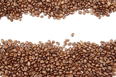 semilla de cafe: Primer de los granos de café en el fondo plano. Copia espacio