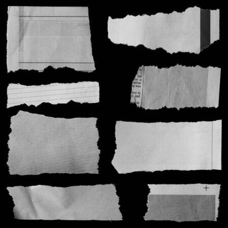 Stukken van gescheurd papier op zwart Stockfoto