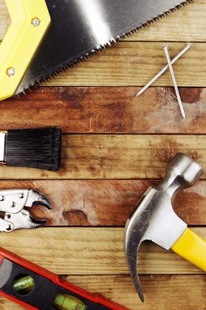 Assortment of tools on wood photo