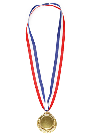 Closeup of gold medal on plain background 스톡 콘텐츠