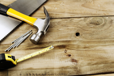 tools construction: Assortment of tools on wood Stock Photo