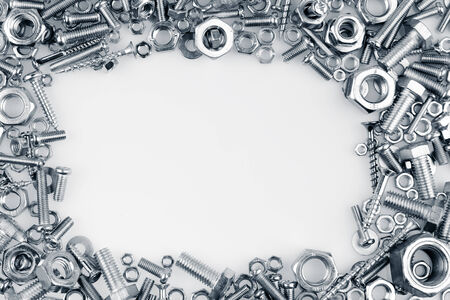 metal fastener: Chrome nuts and bolts, copy space