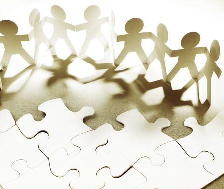 Group of people and jigsaw puzzle pieces Stock Photo