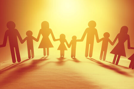 children holding hands: Family paper chain cutout holding hands Stock Photo