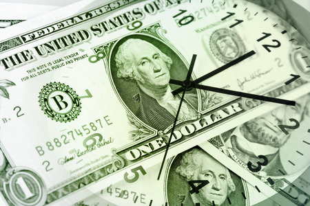 time is money: Clock face and American currency Stock Photo