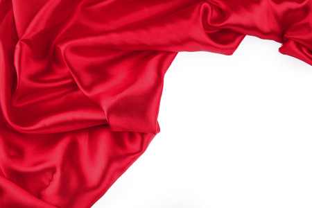 folds: Closeup of folds in red silk fabric on plain background. Stock Photo