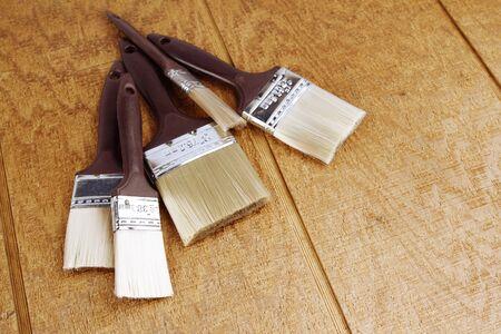 paintbrushes: Assorted paintbrushes on wooden background
