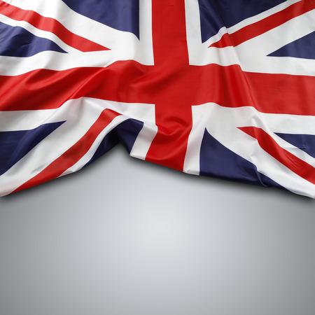 bandera inglesa: Bandera Union Jack en el fondo gris Foto de archivo