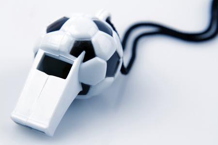 ref: Ball whistle on plain background