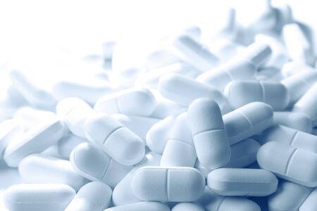 painkiller: Pile of tablets closeup, copy space