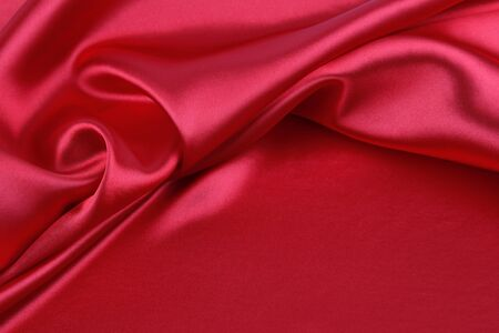 folds: Closeup of folds in red silk fabric